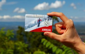 A person holding an America the Beautiful Pass, AKA National Parks annual pass