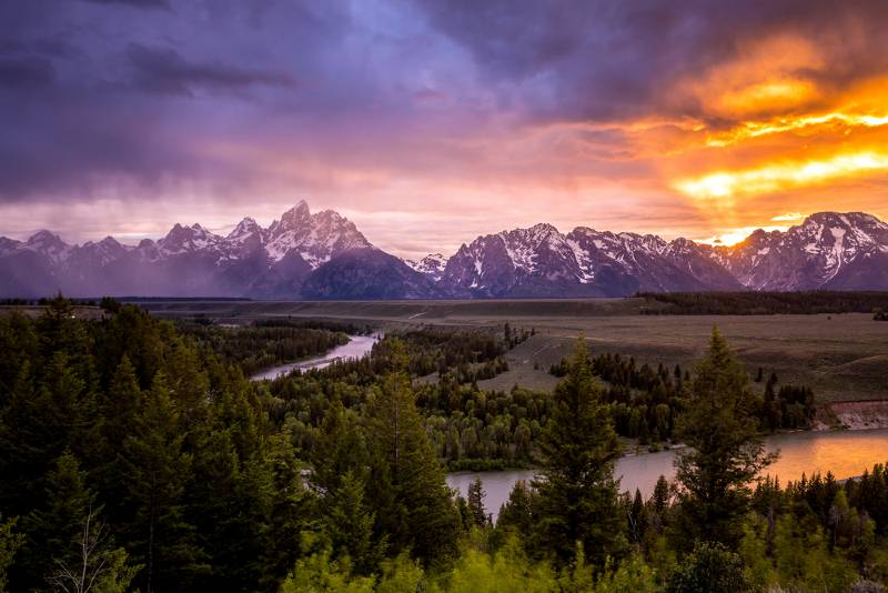 The Grand Tetons at sunset, as seen from the Snake River on one of the Jackon Hole float trips