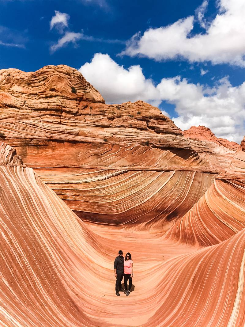 """Two people standing inside """"The Wave"""" after winning The Wave Arizona lottery"""