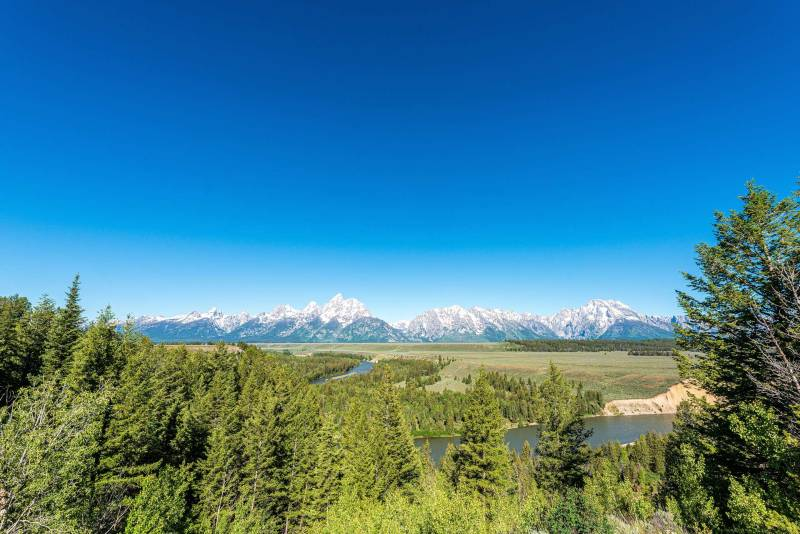 A panorama of the Grand Tetons range, as seen from one of the Jackson Hole float trips