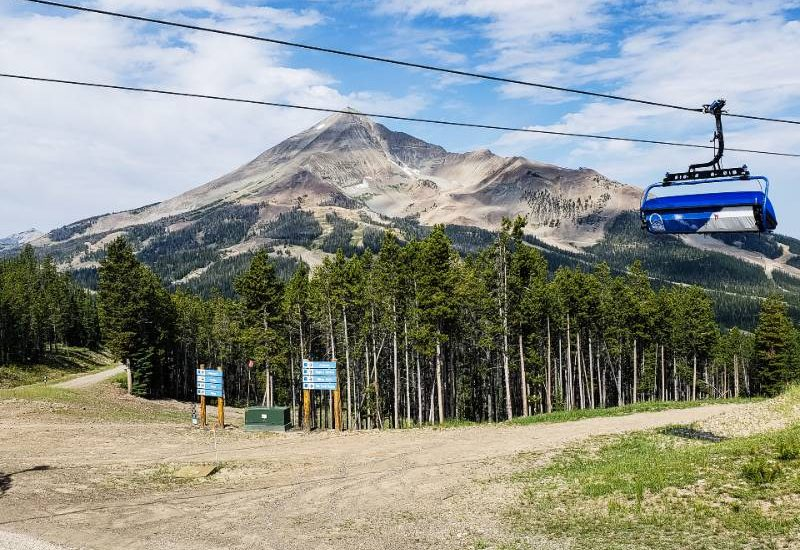 A chairlift passing by Lone Peak in Big Sky, Montana