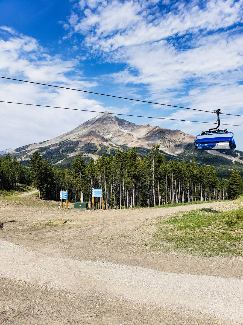 A chairlift passing by Lone Peak in Big Sky Montana