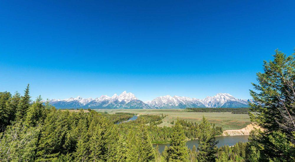 A Snake River float trip takes you right through Grand Teton National Park