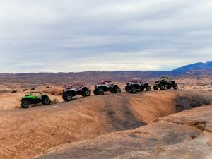 5 UTVs lined up on one of the off road trails in Moab
