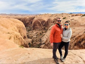 Two people posing near a canyon along one of the off road trails in Moab