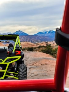 A UTV facing the La Sal Mountains on one of the off road trails in Moab
