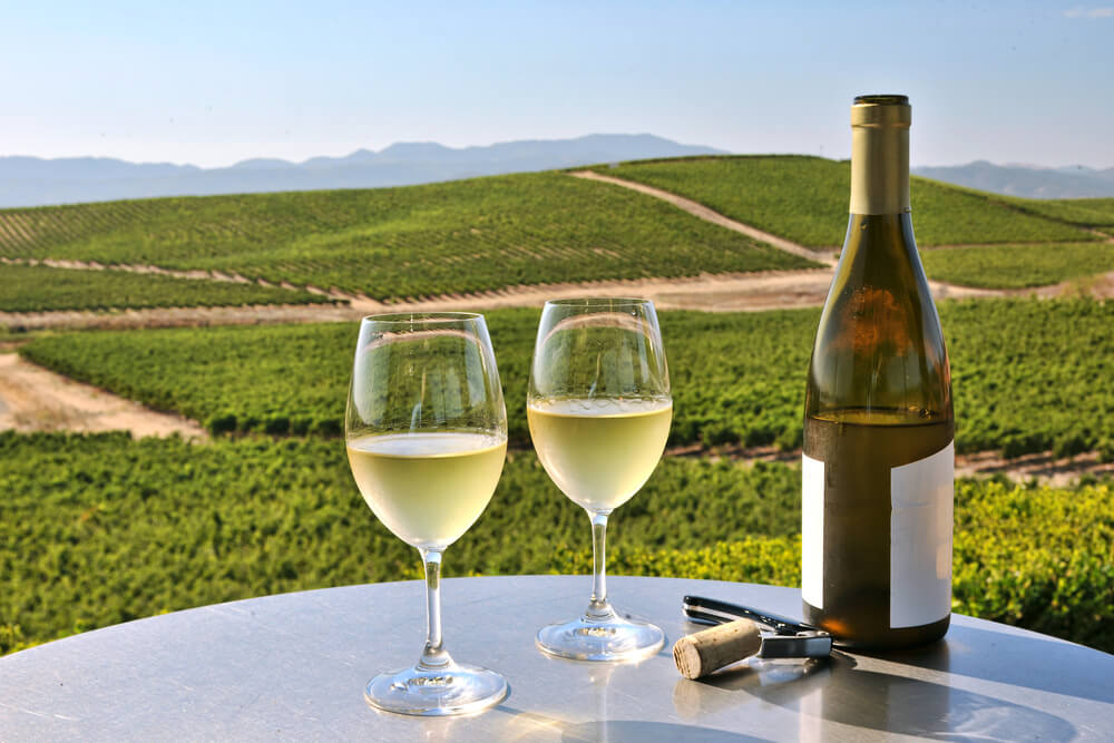 Two glasses and a bottle of wine at one of the most romantic wineries in Napa