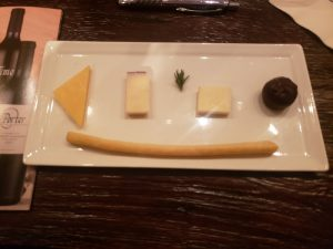 A plate of cheese and chocolate, part of Porter Family's private wine tasting