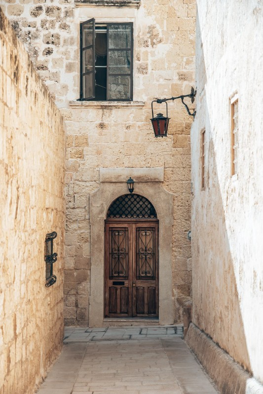 A hidden alleyway and ancient door in Malta, one of the most underrated countries to visit