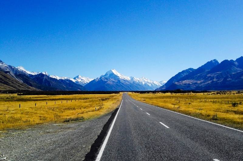 The open road and mountains on a New Zealand cross country road trip