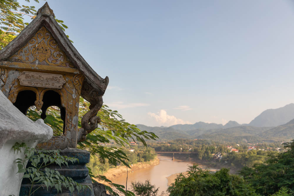 Mountains, lush rainforest, and a building in Luang Prabang, Laos, one of the world's most underrated countries
