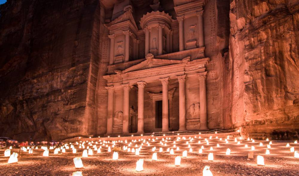 Hundreds of candles on the ground in front of a building in Petra, Jordan, one of the most underrated countries to visit
