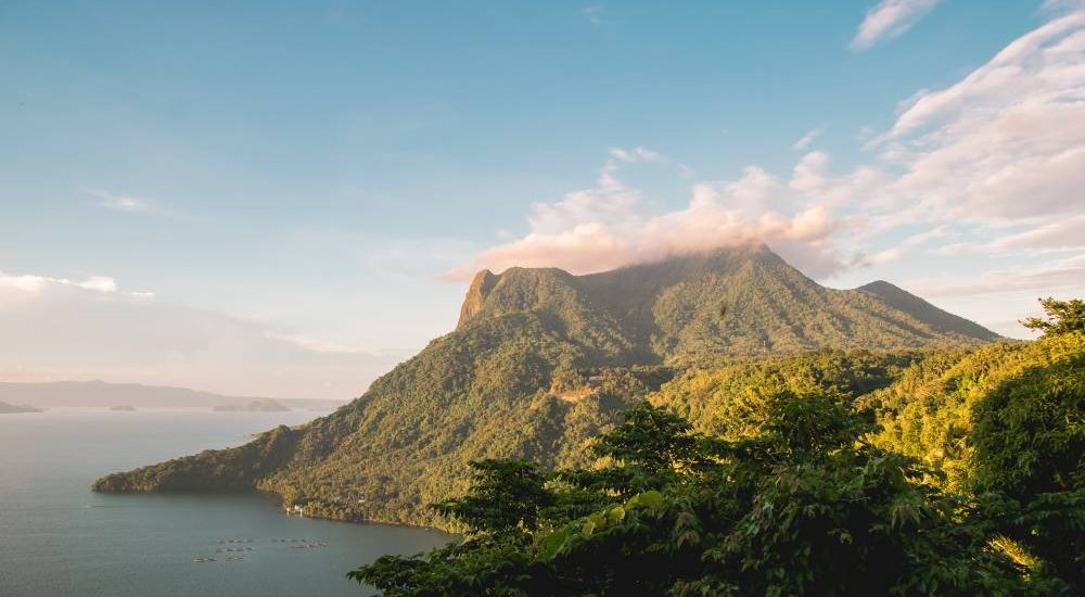 A lush green mountain and sea in the Philippines, one of the world's most underrated travel destinations