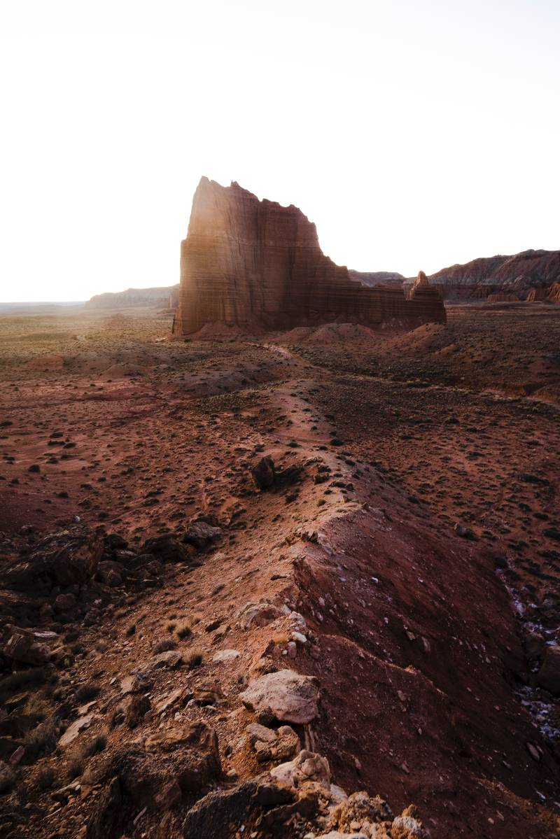 A ridge leading to a large rock formation in Capitol Reef, one of the most underrated national parks