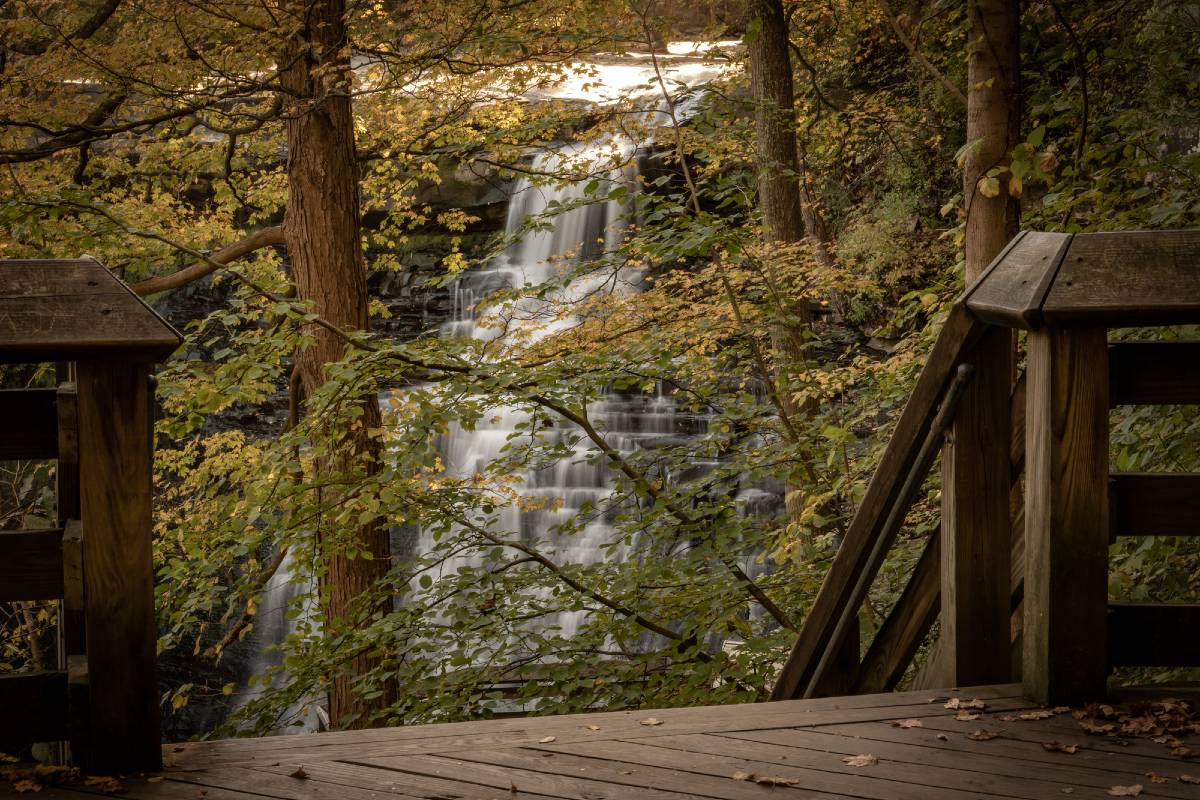 Brandywine Falls as seen from an observation deck in Cuyahoga Valley National Park, one of the most underrated national parks in the US