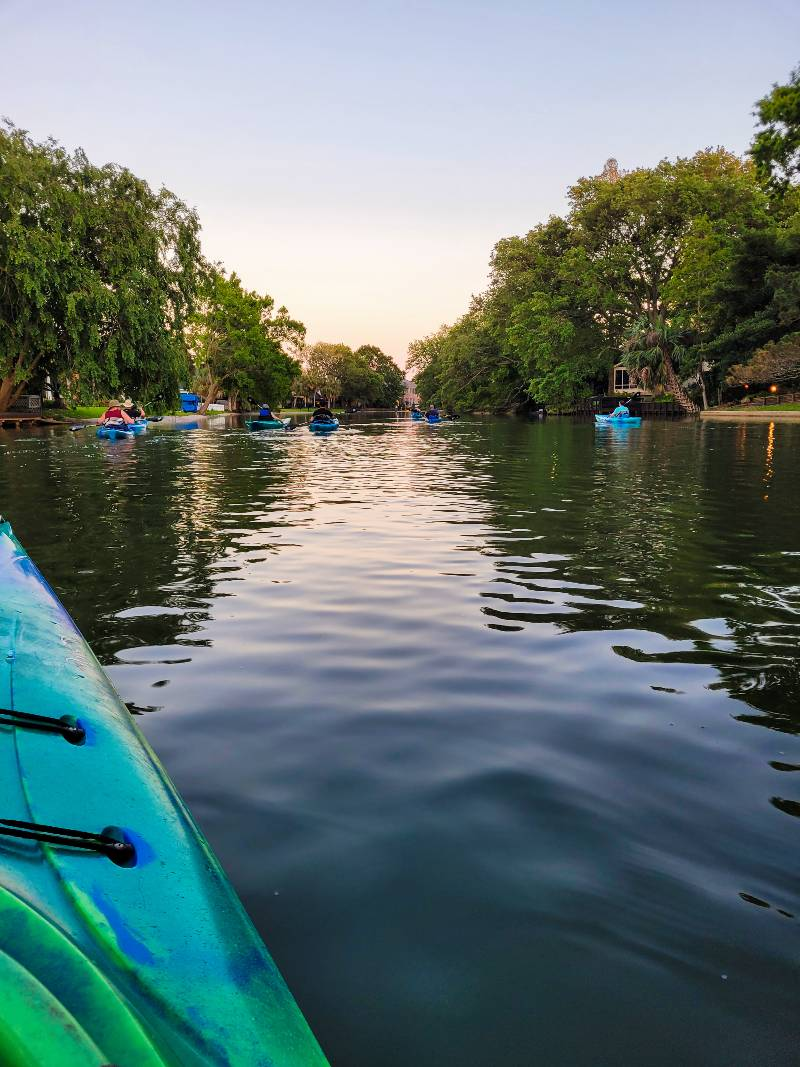 A group of people kayaking on Bayou St. John, one of the best water activities in New Orleans
